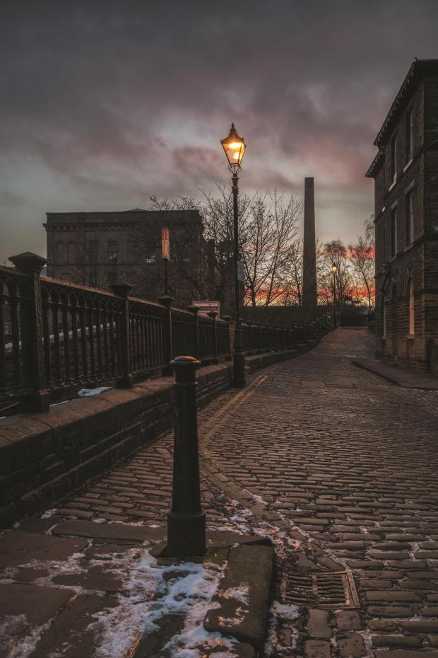 Bradford Telegraph and Argus: Atmospheric street scene in Saltaire