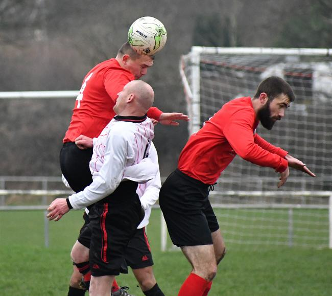 Wayne Broxholme (red, left) was on target for Tyersal in their 4-3 in at Bolton Woods Picture: Richard Leach