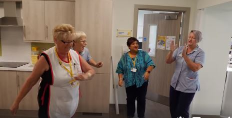 Staff and volunteers at Bradford hospice burst into song