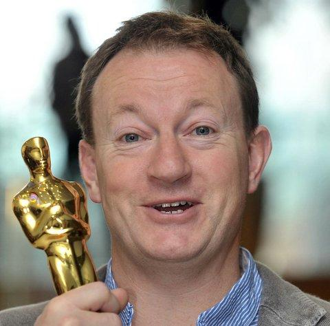 Simon Beaufoy with his Oscar for Slumdog Millionaire