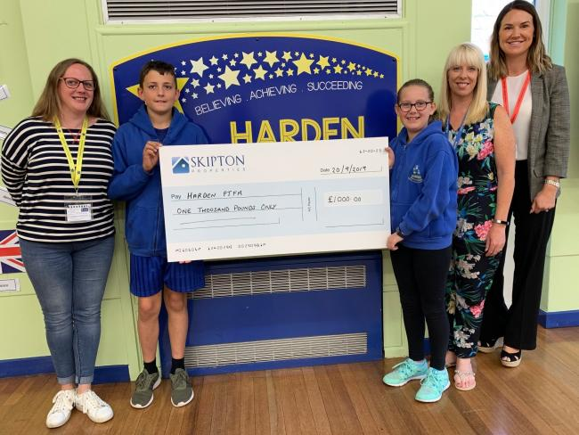 Pupils receiving the cheque are pictured with, from left, Jenny Hird of the PTFA, headteacher Kirsty Hutchinson and Sarah Barraclough of Skipton Properties