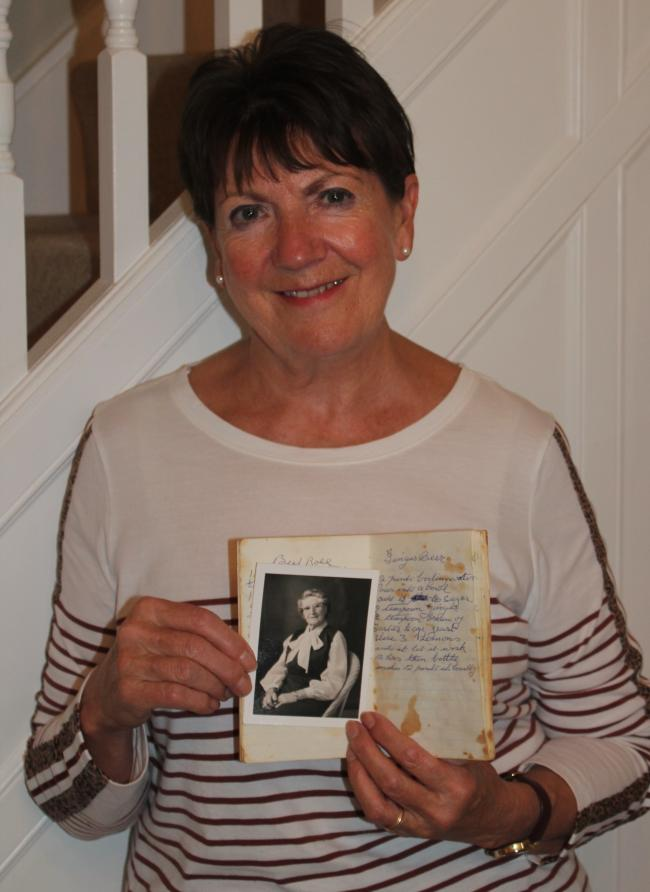 Carol Morrell Smith with a photograph of her grandma and the notebook in which the original ginger beer recipe appears