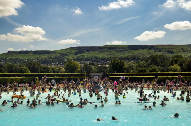 People enjoy the sun at Ilkley outdoor pool and lido (Picture Danny Lawson/PA Wire)