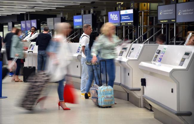 Passengers prepare to check in at Leeds Bradford Airport