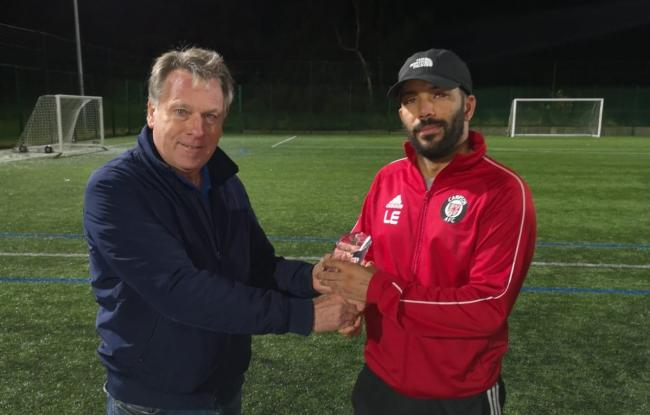 Louis Etienne receiving the WYAFL Division One manager of the month award for September Picture: @CampionAFC (Twitter)