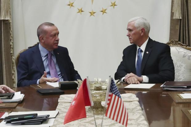 Turkey's President Recep Tayyip Erdogan, left, talks with US vice president Mike Pence