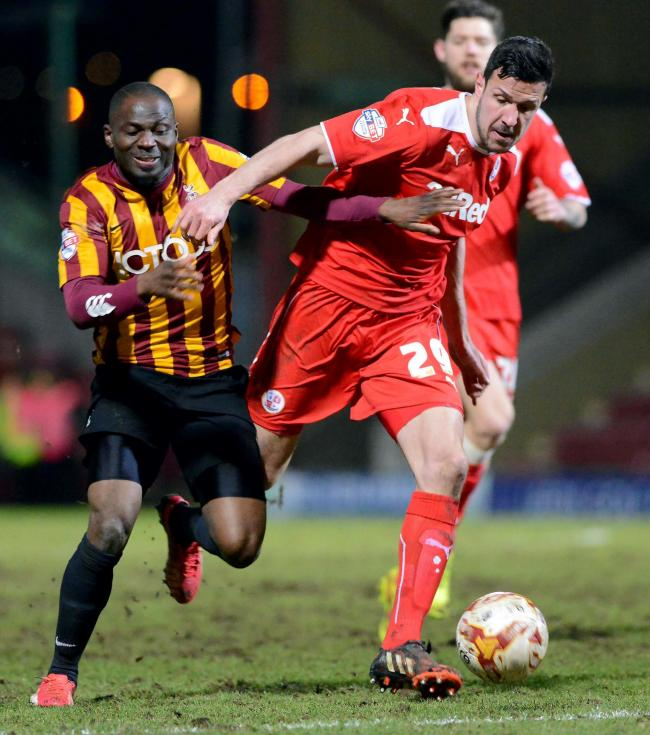 Goalscorer Francois Zoko battles with Crawley defender Richard Wood in City's 1-0 win in 2015.