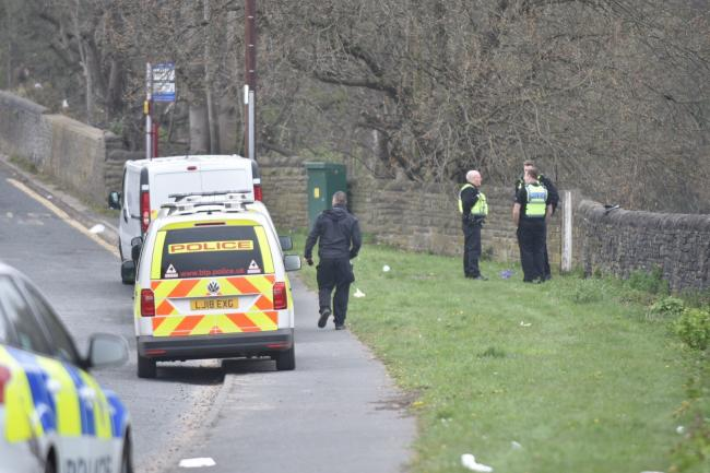 Police at the scene of the railway near Brighouse, where Anthony Llewellyn King, was killed when struck by a train