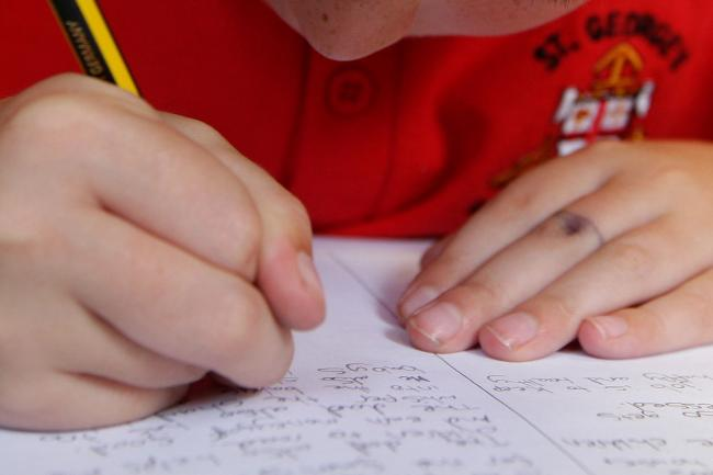Embargoed to 0001 Wednesday March 4..File photo dated 06/07/11 of a boy writing in class, as England's state secondary schools are still failing their brightest pupils, inspectors have warned. PRESS ASSOCIATION Photo. Issue date: Wednesday March 4, 20