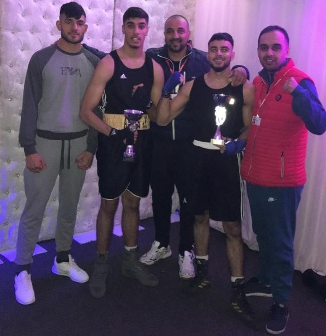 "Anees Iqbal (second left) and Hishaam Ahmed (fourth left) celebrate their trophies in Leeds with coach Inzar ""Inzy"" Ahmed (centre)"