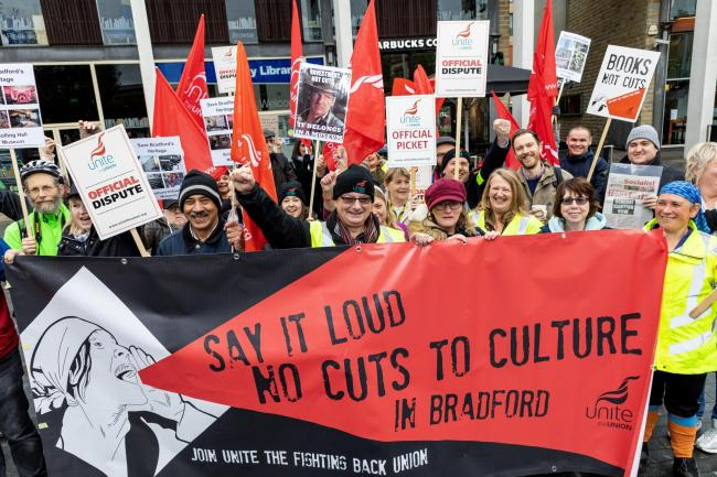 Campaigners fight for Bradford's museums and libraries in a 14-day strike. Pictured outside City Library in Bradford. Picture: Neil Terry