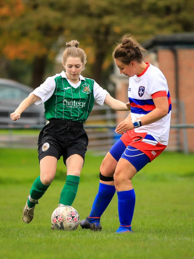 Alice McUrich (left) netted Avenue's only goal in their heavy league defeat at home to Wakefield Trinity Picture: Steve Biltcliffe Photography