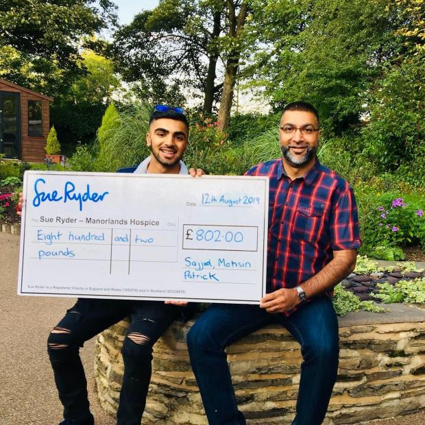 Bradford Telegraph and Argus: Sajjad Sasiq climbed Ben Nevis with his son for Manorlands Hospice