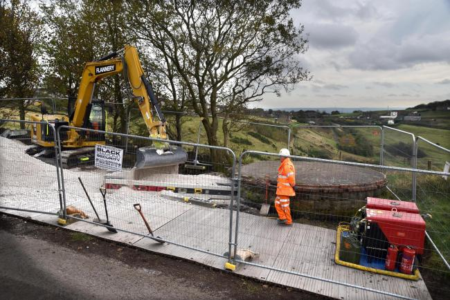 Engineers put material down a ventilation shaft of Queensbury tunnel as part of the emergency works