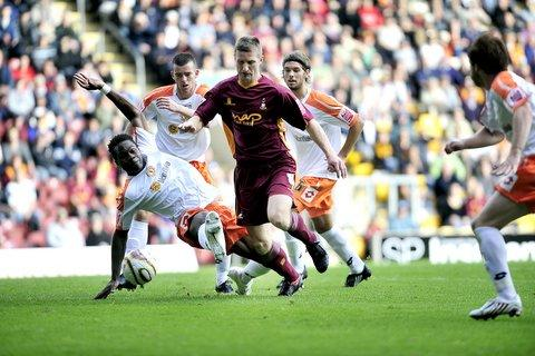 Lee Bullock powers forward during an impressive display for City