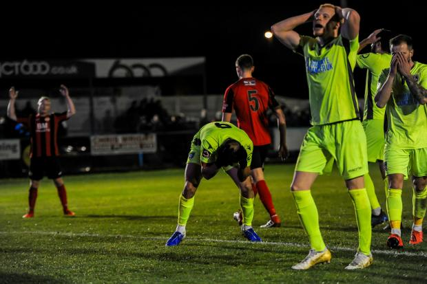 Guiseley players can't believe it as a chance goes begging   Picture: Tom Pearson