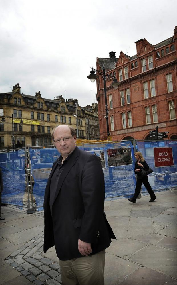 Councillor Adrian Naylor on the site of the works in Ivegate