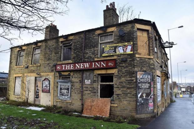 The New Inn on Manchester Road (above) and the interior of the building (below)