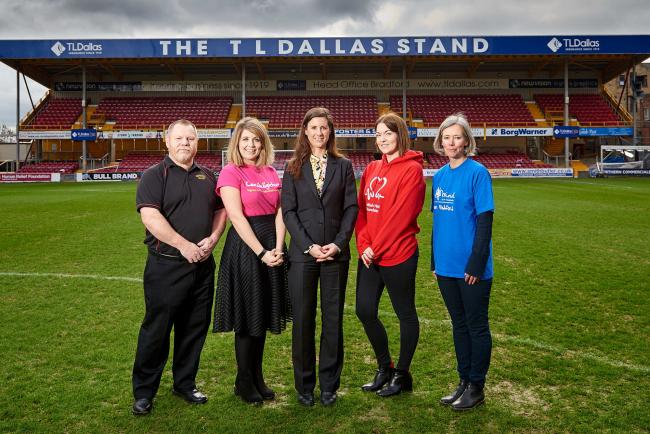 TL Dallas managing director Polly Staveley (centre) pictured with charity representatives