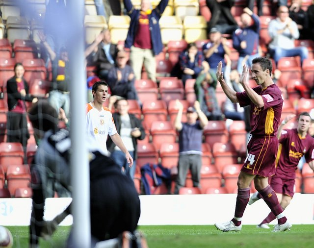 Michael Boulding celebrates after scoring City's first goal against Crewe, who held on for a 3-2 victory after surviving a late claim for a penalty