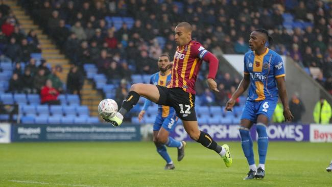 James Vaughan takes on the Shrewsbury defence before going off injured. Pic: Thomas Gadd