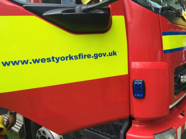 Man in custody over arson attack which trapped couple in their flat