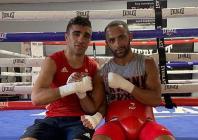 Muhammad Ali (left) has been sparring world title challenger Kid Galahad in his time outside the ring