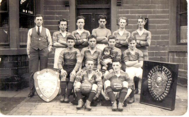 A Wilsden FC team group picture from 1931 featuring future England international Jeff Hall as mascot