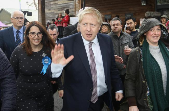 Boris Johnson visit to the Winter Fair in Builth Wells. .Pictured is Boris Johnson and Fay Jomes..Picture by Phil Blagg..PB574-2019-34.