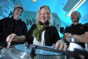 Emma takes a lesson from DJs Ed Williams and Nick Merrick at the Waxworks studio