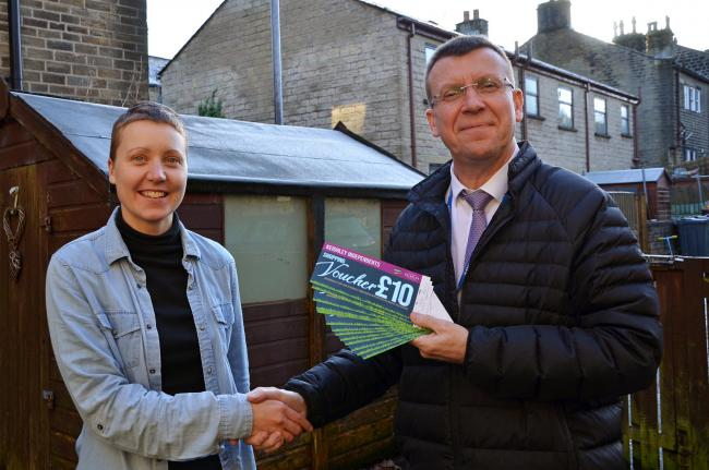 Ruth Nielsen receives her vouchers from Phil Walker, of Keighley BID