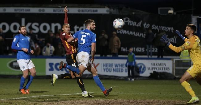 James Vaughan heads City's equaliser at Macclesfield. Pic: Thomas Gadd