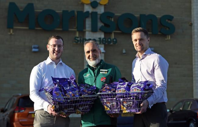 Morrisons has donated hundreds of bars of chocolate to The Bradford Soup Run for part of its Chox 'n' Sox Appeal. At the Girlington store are Luke Walsh and Alistair Widdop of the Soup Run's street team and Ashad Akram from Morrisons.