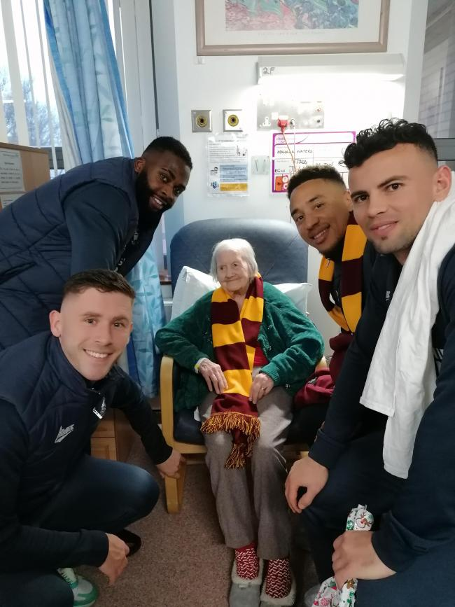 Bradford City's Hope Akpan, Shay McCartan (left), Adam Henley and Zeli Ismail (right) with May Waters, 104.
