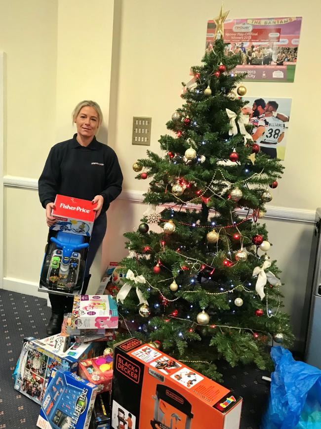 Gifts and food donated to the Telegraph and Argus Toys & Tins Appeal have been handed over to a charity which helps women and children fleeing domestic violence