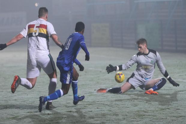 Simeon Cobourne slots it past Green to put the home side in front. Picture: Steve Evans