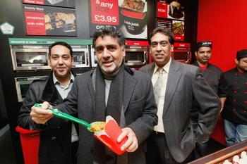 Dragon's Den star James Caan, centre, with Rab Nawaz, left, and Mumtaz Khan, right, of Mumtaz