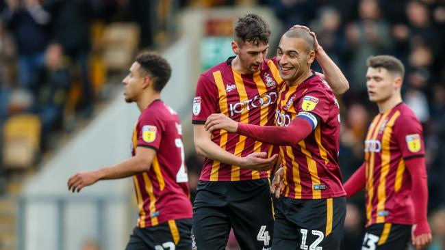 From left, Paudie O'Connor and James Vaughan celebrate Bradford City's 2-0 win over Mansfield Town at Valley Parade yesterday. Picture: Thomas Gadd