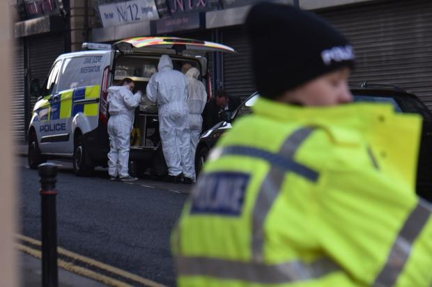 Bradford Telegraph and Argus: Police and forensic officers at the scene in Batley
