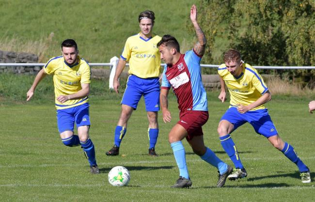 Rawdon Old Boys' Craig Nicholls (claret and blue) scored twice for his side in a 6-1 win over Glasshoughton Rock Picture: Richard Leach