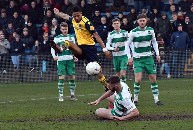 Guiseley's Kaine Felix (yellow and navy) scored on the road for his side over Christmas, and he will be hoping to do the same at home to Chester tomorrow Picture: Richard Leach