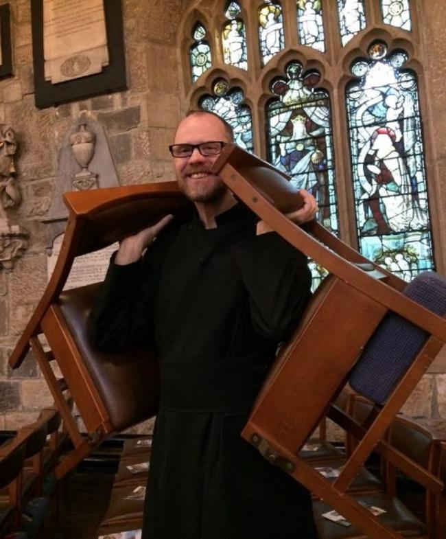 Head verger David Worsley carrying two of the current chairs used in Bradford Cathedral