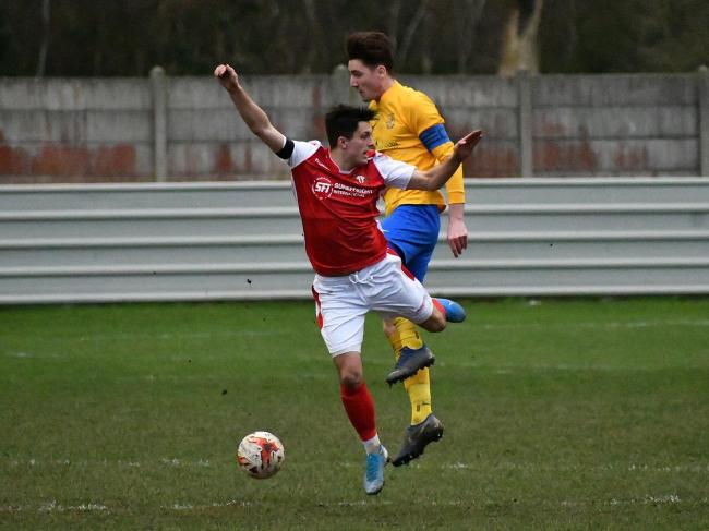 Thackley's Jack Normanton (red) in action during his side's 4-0 win over Albion Sports earlier this month Picture: Richard Leach