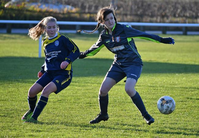 Ilkley Town Ladies v Farsley Celtic Ladies.Tash Sunderland  (left) for Ilkley takes on Lauren Rigby.Picture: Richard Leach.