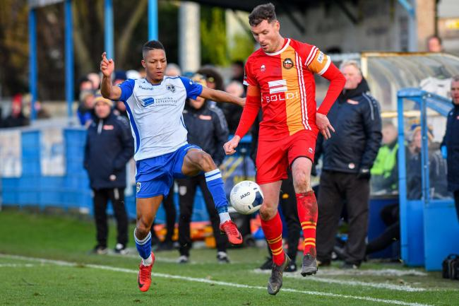Kaine Felix, left, equalised for Guiseley but it proved in vain