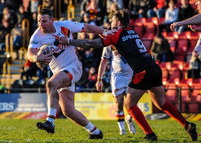 Sam Barlow, left, broke his arm in Bulls' defeat to Dewsbury Rams yesterday. Picture: Tom Pearson