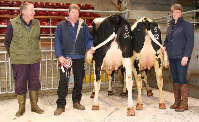 Peter Baul, second left, with his latest champion and reserve. Picture: Moule Media