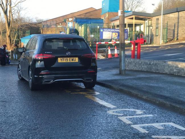 The driver of this car regularly parks (not only to drop-off kids) on this same spot every morning (8.30-8.45) in front of Poplars Farm Primary School and Nursery and creates a road block and safety hazard for all other road users especially the kids/parents crossing the road. As we all know this type of parking (on 'keep-clear' markings) is illegal and as a matter of fact it also shows a clear disrespect to all the efforts that both the parents and the school combinedly put forward to maintain a safe environment for the kids. I've requested the school to make a note of this as a matter of urgency and try to warn this driver of their unacceptable attitude and practice.