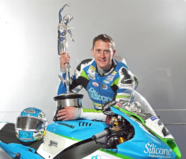 Dean Harrison poses with the Isle of Man TT trophy after winning it last year Picture: Stephen Davison