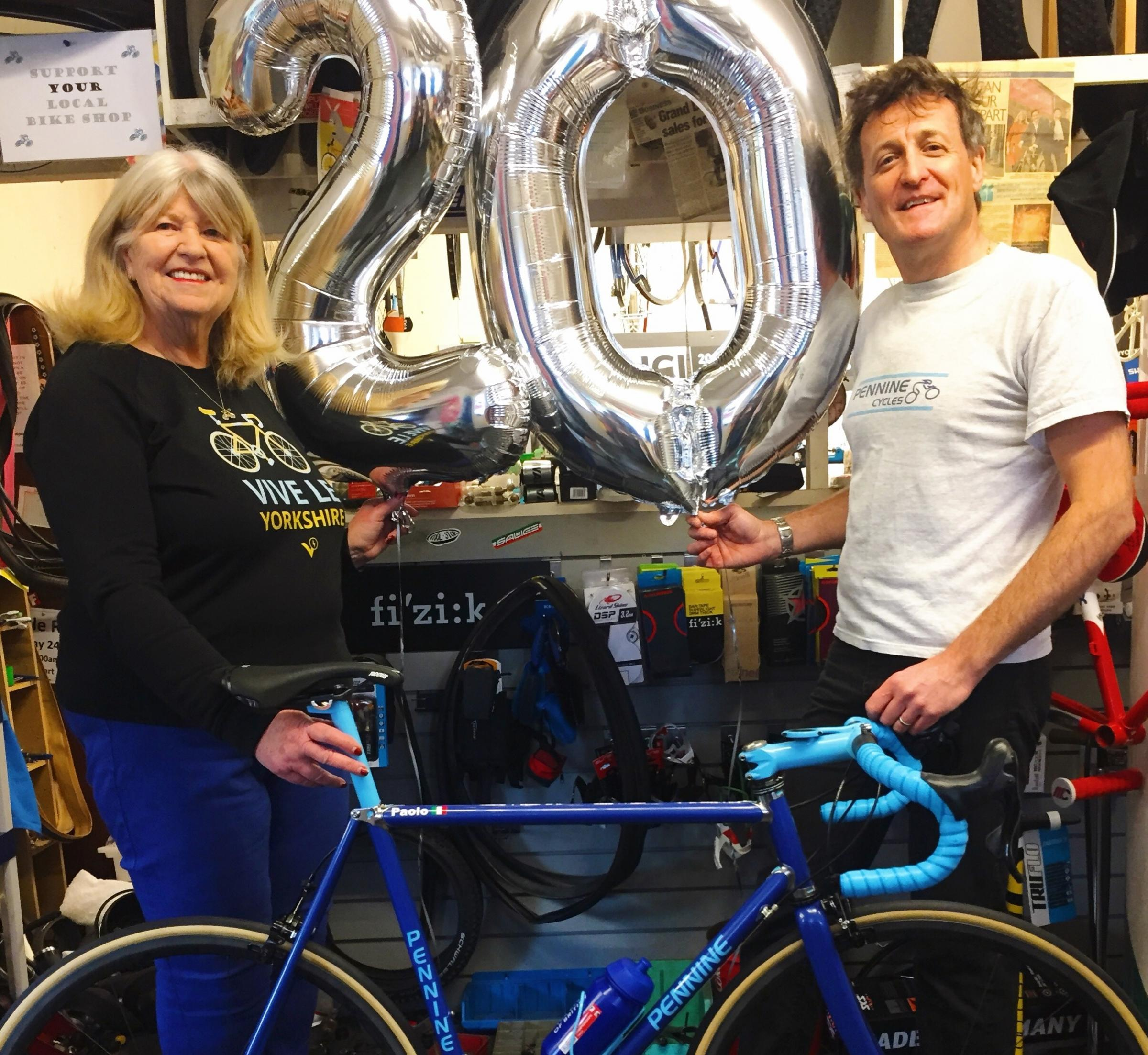 Couple mark two decades at bike shop